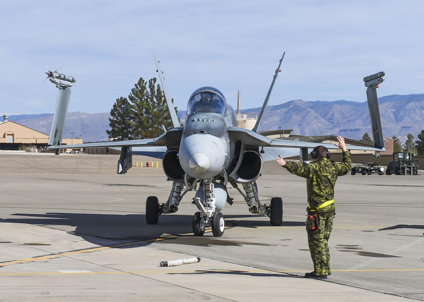 RCAF member directs a CF-18 Hornet at Holloman Air Force Base NM 13 Feb 2018 - USAF photo by SA Chase Cannon 180213-F-GO091-073