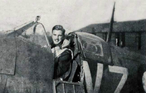 Pilot Officer John Gillespie Magee Jr in the cockpit of 412 Squadron Supermarine Spitfire - RAF photo
